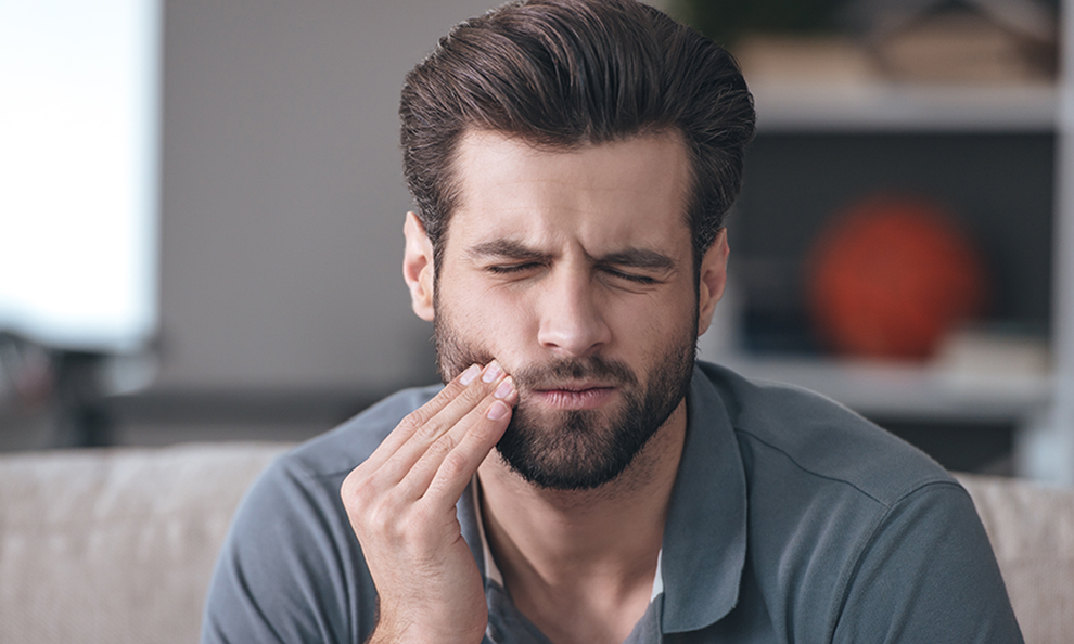 Image of a man with a toothache.